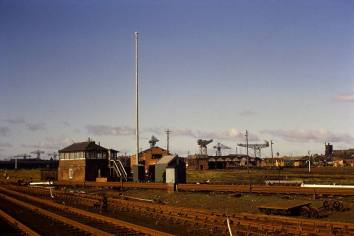 Barrow shed in its final days in the 1970s – still no roof and only diesels around. This view gives some impression of the large size of the site. The remains of the coaling stage and water tank are still on site. Photo Courtesy: George Mason